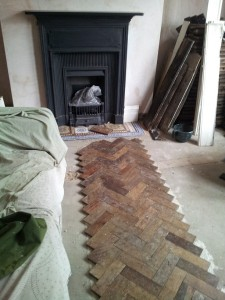 Diy reclaimed parquet flooring installation parquet parquet diy reclaimed parquet flooring installation 2 laying the central section solutioingenieria Gallery